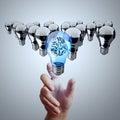 Hand reach d metal brain inside light bulb of leadership concept Royalty Free Stock Photography