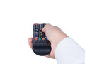 Hand with remote control pointing forward Royalty Free Stock Photo