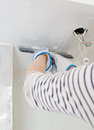 Hand repairs gypsum plasterboard frame with spackling paste Stock Photo