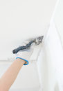 Hand repairs gypsum plasterboard frame with spackling paste Royalty Free Stock Photography
