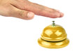 Hand ringing in yellow service bell on white background Royalty Free Stock Photography