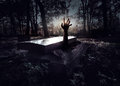Hand rising out from the grave halloween concept Stock Photo