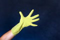 Hand in rubber glove on the dark background Stock Photo