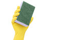 Hand with a rubber glove holding a sponge Royalty Free Stock Photo