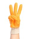 Hand in rubber glove shows three isolated on a white background Royalty Free Stock Images