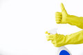 Hand in rubber yellow glove holds  spray bottle of liquid detergent on white background. cleaning Royalty Free Stock Photo