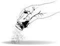 Hand with the salt shaker