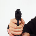 Hand with a semi automatic gun pointing forward close up closeup Royalty Free Stock Photography