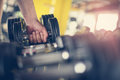 Hand of senior man. Holding weight. Man workout in the Royalty Free Stock Photo