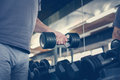 Hand of senior man. Man holding weight. Workout in gy Royalty Free Stock Photo