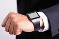 Hand serving smart watch business man empty screen copy space is great for your design Royalty Free Stock Photography