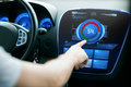 Hand setting volume on car audio stereo system Royalty Free Stock Photo