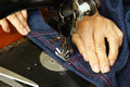 Hand sewing on a machine denim dress Royalty Free Stock Photography
