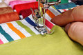 Hand sewing on a machine Royalty Free Stock Photo