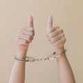 Hand in shackle Royalty Free Stock Photo