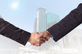 Hand shake between a businessman on Modern business building gla Royalty Free Stock Photo
