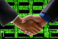Hand shake with circuit board background Stock Photo