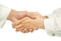Hand shake in front of a white background Royalty Free Stock Photography