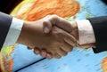 Hand shake over globe Royalty Free Stock Photo