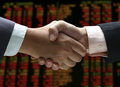 Hand shake at stock index Stock Image