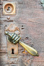 Hand shaped vintage doorknob on antique door knob from the medieval city of bamberg in bavaria germany Stock Image