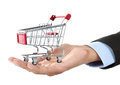 Hand and shopping cart Royalty Free Stock Image