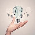Hand showing d light bulb as vintage concept Royalty Free Stock Photography