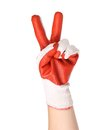 Hand shows two in a red rubber glove isolated on white background Royalty Free Stock Photo