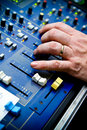 Hand on sound control board Royalty Free Stock Photo