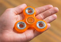 Hand with spinner toy Royalty Free Stock Photo