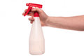 Hand with spray bottle a of a man holds a isolated on a solid white background Stock Photo