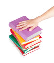 Hand with a stack of books Royalty Free Stock Photo