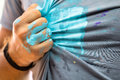 Hand stained by a blue paint wipe out the color of a shirt as ar Royalty Free Stock Photo