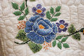 Hand stitched embroidered flower on an amish quilt spotted at a rural farm auction in delaware Stock Images