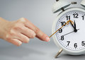 Hand stop alarm clock, time management concept Royalty Free Stock Photo