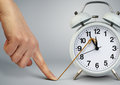 Hand stop time on alarm clock, deadline concept Royalty Free Stock Photo