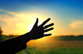 Hand On Sunset Background Royalty Free Stock Photos