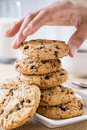 Hand taking cookie Royalty Free Stock Photo
