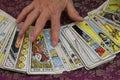 Hand on Tarot Cards