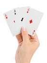 Hand with three aces isolated on white background Stock Photos