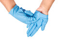 Hand throwing away blue disposable gloves. Royalty Free Stock Photo