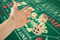 Hand throwing three dices over casino table green Royalty Free Stock Photo