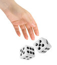 Hand throwing two dices Royalty Free Stock Photo