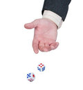Hand throws dice. Royalty Free Stock Image