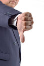 Hand thumb down by businessman. Rejection symbol