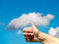 Hand with thumb in the sky clouds blue Stock Photo