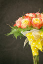 Hand tied rose bouquet close up of wedding with bi colored red and yellow roses twigs and greens with sheer and polka dot yellow Royalty Free Stock Photos