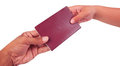 Hand to hand and holding red passport Royalty Free Stock Photo