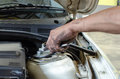 Hand with tool in process of car fix