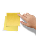 Hand touch blank yellow sticky note on white background Royalty Free Stock Photos